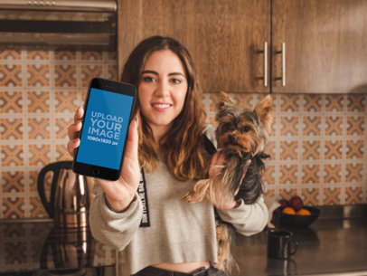 Mockup of a Girl Holding an iPhone 8 and Her Dog a19638