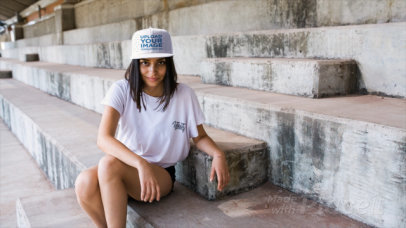 Young Hispanic Girl Wearing a Snapback Hat Video Sitting on Concrete Stairways a14203
