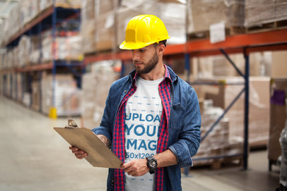 Supervisor Wearing a T-Shirt Mockup at the Warehouse a20381
