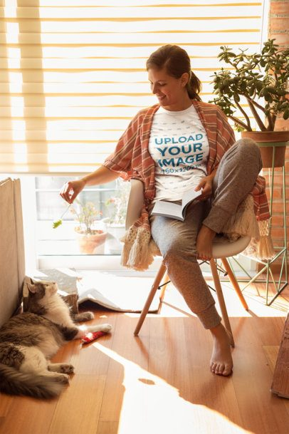 Woman Playing with her Cat Wearing a Tshirt Mockup a18972