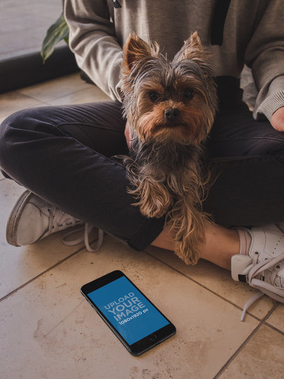 Space Gray iPhone Mockup Lying Near a Girl with her Dog a19643