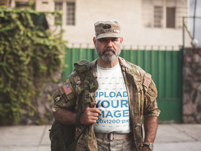 T-Shirt Mockup Featuring a Soldier in Army Gear on the Street a20632