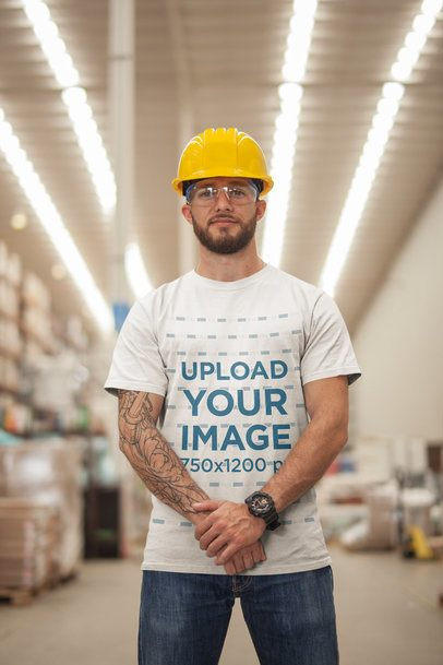 Man Wearing a T-Shirt Mockup and a Yellow Hard Hat a20383