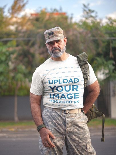 T-Shirt Mockup Featuring a Veteran Wearing Uniform on the Street a20631