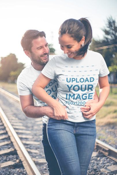 Loving Man and Woman Wearing Tshirts Mockup by the Tracks a20614