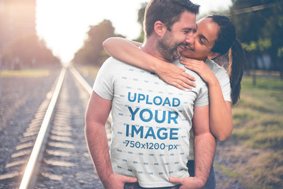 Man Wearing a Tshirt Mockup by the Rail Trail with his Wife a20615