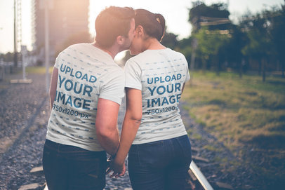 Back Shot of a Loving Couple Wearing T-Shirts Mockup a20616