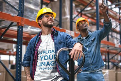 Industrial Worker Wearing a T-Shirt Mockup with his Friend at the Warehouse a20379