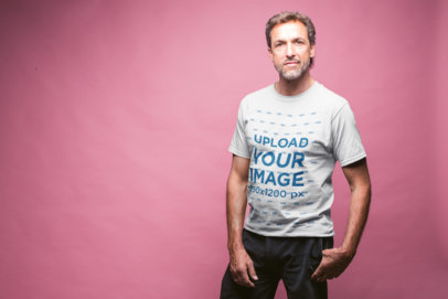 Front Shot Tshirt Mockup of a Man in a Pink Photo Studio a20323