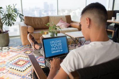 Mockup of a Man Working with his MacBook at Home a20763