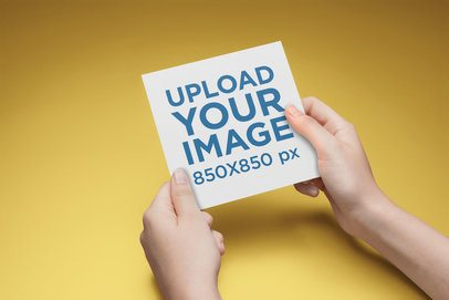 Square Postcard Mockup Being Held with Both Hands a20563