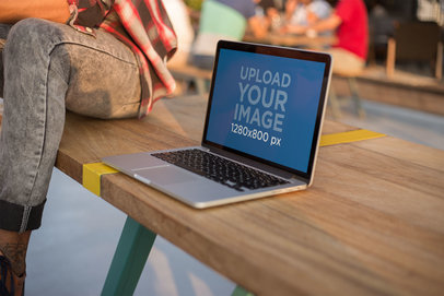 MacBook Mockup Standing on a Wooden Bench a20771