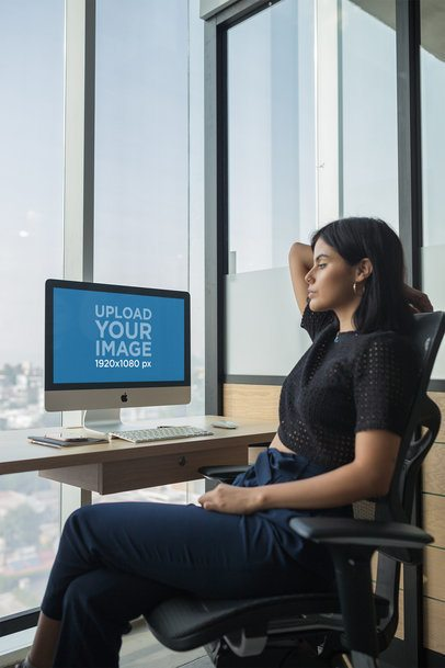 Girl Watching her iMac Mockup at the Office a20760