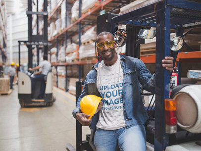 T-Shirt Mockup Featuring a Black Man Wearing Construction Gear at a Warehouse a20447