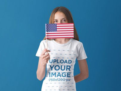 Patriot White Girl Holding a Small American Flag Wearing a T-Shirt Mockup a20704