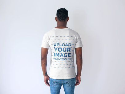 Back Shot Tshirt Mockup of a Man Facing a White Wall 20739