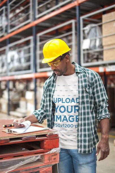 Industrial Worker Going Through a Checklist Wearing a T-Shirt Mockup a20444