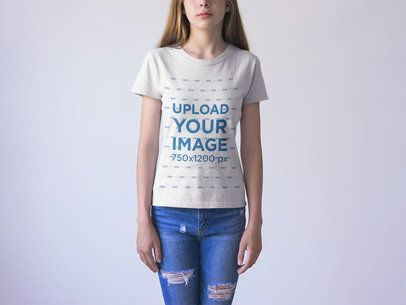 Closeup of a Woman Wearing a Generic T-Shirt Mockup Against a White Background a20736