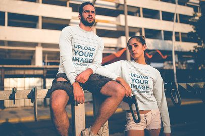 Hipster Couple Wearing Crewneck Sweaters Mockup Outside a Building in the Afternoon a20592
