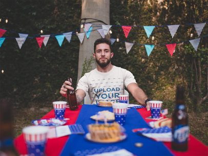 T-Shirt Mockup Being Worn by a Man at a 4th of July BBQ Party a20818