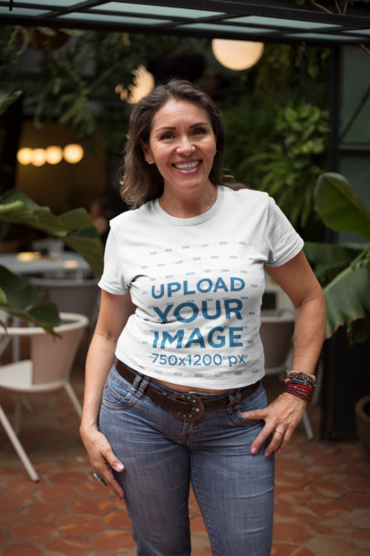 Senior Woman Posing Wearing a T-Shirt Mockup at a Coffee Shop a20364