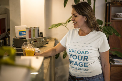 Senior Woman Ordering at a Coffee Shop Wearing a T-Shirt Mockup a20365