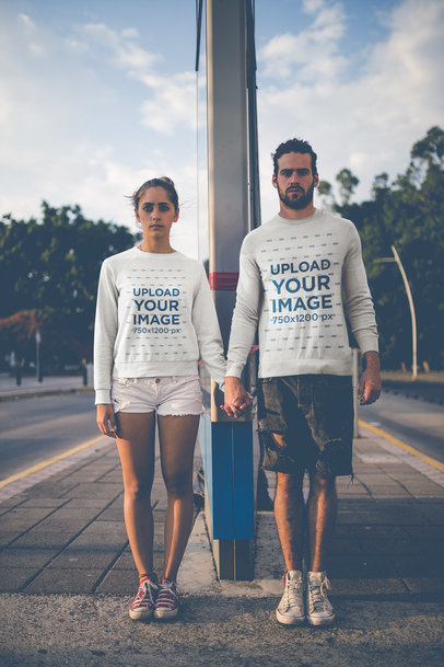 Serious Couple Holding Hands Wearing Crewneck Sweaters Mockup Outdoors a20593