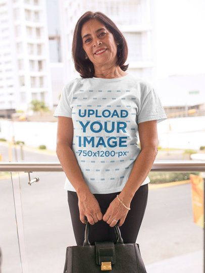 Portrait of an Elder Woman Wearing a T-Shirt Mockup Holding a Bag a20358