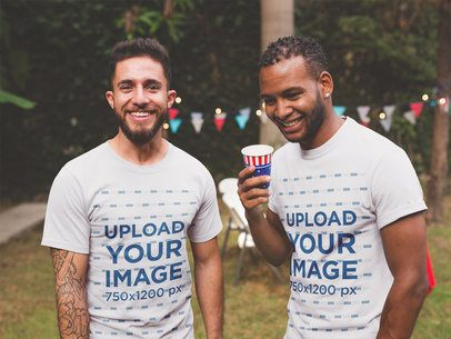 Interracial Pair of Friends Wearing T-Shirts Mockup at a 4th of July BBQ Party a20824