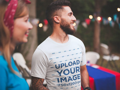 Smiling Bearded Man Wearing a T-Shirt Mockup at a 4th of July BBQ Party a20841