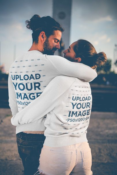 Back Shot of a Couple Wearing Crewneck Sweaters Mockup While Hugging a20596