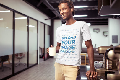 Smiling Man Wearing a Tshirt Mockup Having a Coffee at the Office a20524