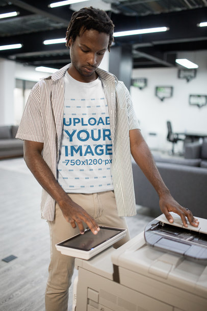Portrait of a Man with Short Dreadlocks Wearing a Tshirt Mockup Using a Printer a20514
