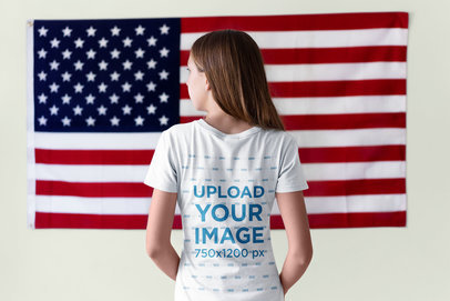 Back of a Girl Wearing a Tshirt Mockup Facing a Hanging American Flag a20701