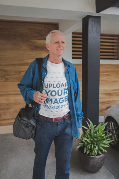 Senior Man Wearing a Tshirt Mockup Getting out of his House a20486
