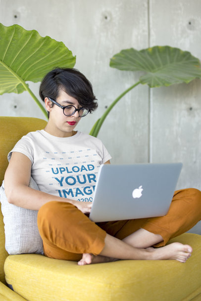 Girl Working on her Laptop Wearing a Tshirt Mockup a20414