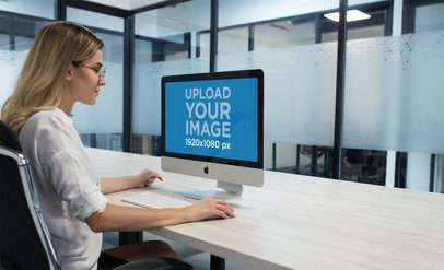 Blonde Woman Using an iMac Mockup at the Office a20969