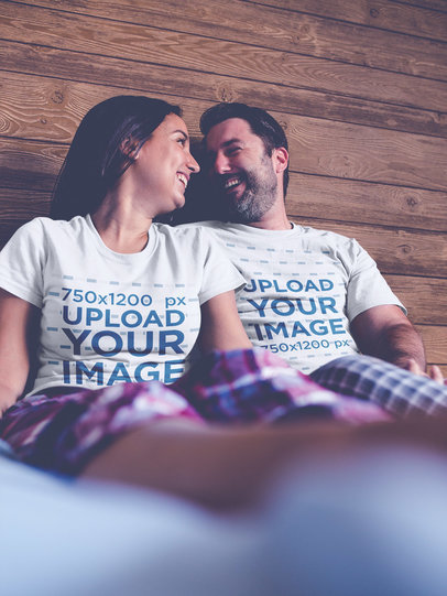 Smiling Couple Wearing Round Neck Tees Mockup Talking on Bed a20605