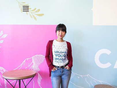 Girl at a Startup Wearing a T-Shirt Mockup Against a Decorated Wall a20407