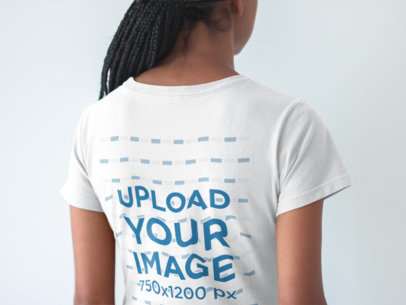 Closeup of the Back of a Tshirt Mockup Being Worn by a Black Girl with Braids a20897