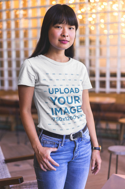 Asian Girl Wearing a T-Shirt Mockup at a Startup a20401
