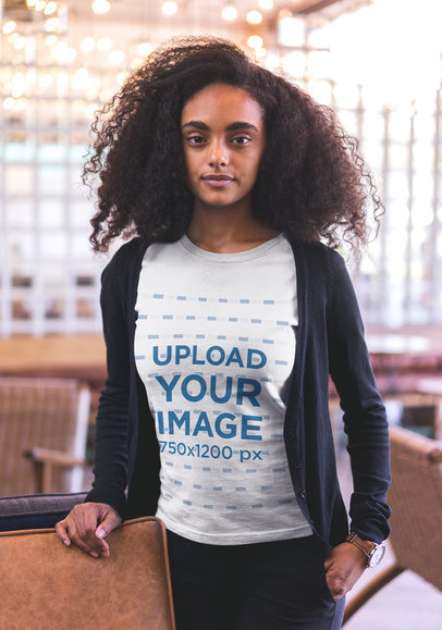 Black Woman with Curly Hair Wearing a Tshirt Mockup a20424