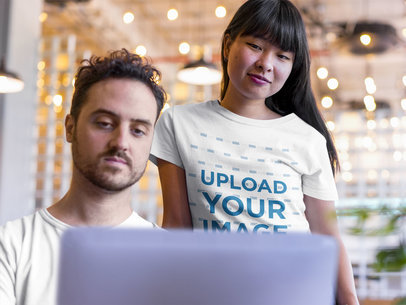 Girl Wearing a TShirt Mockup while with her Coworker a20402
