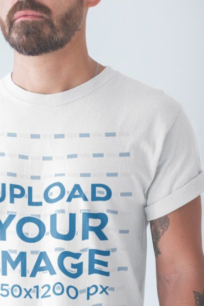Closeup Tshirt Mockup of a Man with a Beard Wearing in a White Room a20895