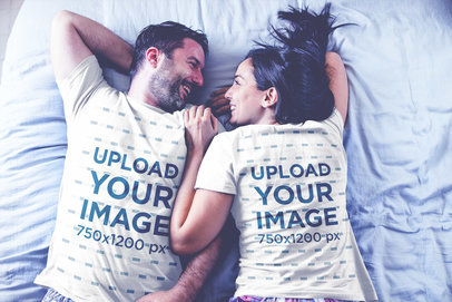 Back and Front Sides of T-Shirts Mockup Being Worn by a Happy Couple Resting on Bed a20604