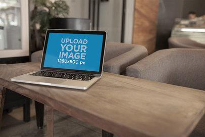 Open MacBook Mockup Standing on a Dark Wooden Bench a20997