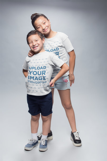 Mockup of Happy Kids Wearing Round Neck Tees at a Photo Studio a20947