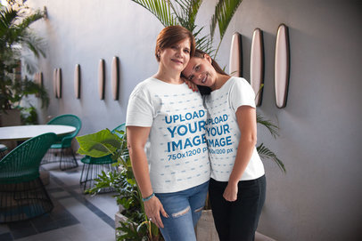 Woman and Daughter Wearing T-Shirts Mockup while Hugging a20727
