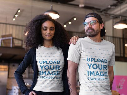 African-American Girl with a Hipster Friend Wearing T-Shirts Mockup at a Startup a20423