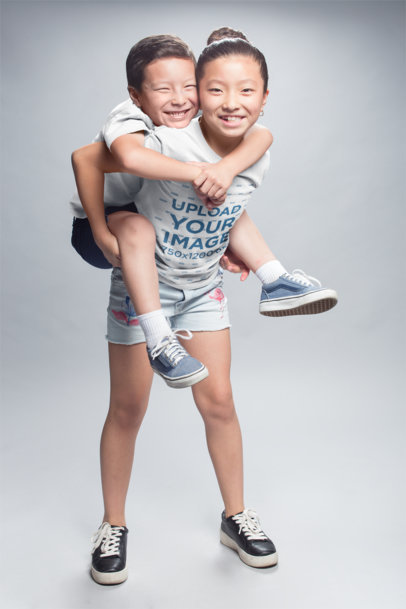 Asian Girl Wearing a Tshirt Mockup Carrying her Brother a20948
